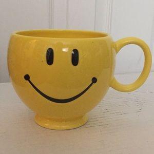 Smiley face coffee mug.
